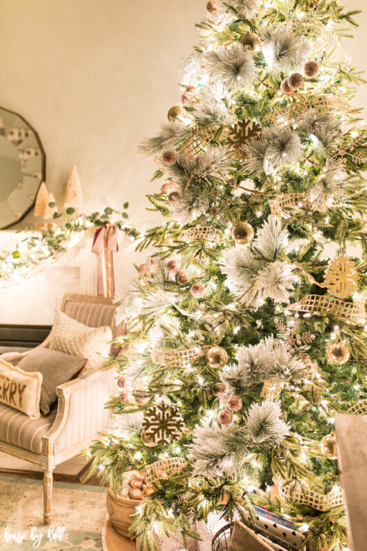 A Christmas tree decorated in gold and white with soft burlap.