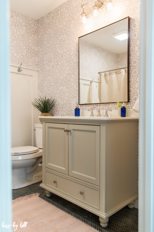 DIY Guest Bathroom Makeover with Wallpaper, Greige Vanity, Rectangle Mirror and Chrome Light Fixture