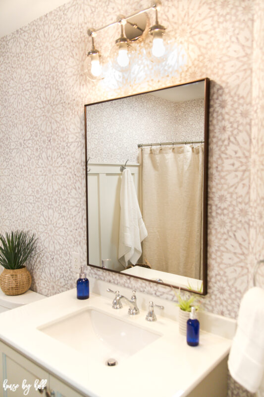 Bathroom Wallpaper with Bronze Rectangular Mirror and Chrome Light Fixture