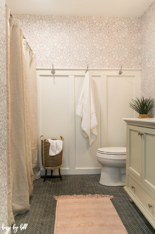 Bathroom Remodel with Wallpaper, Herringbone Floor, and Board and Batten
