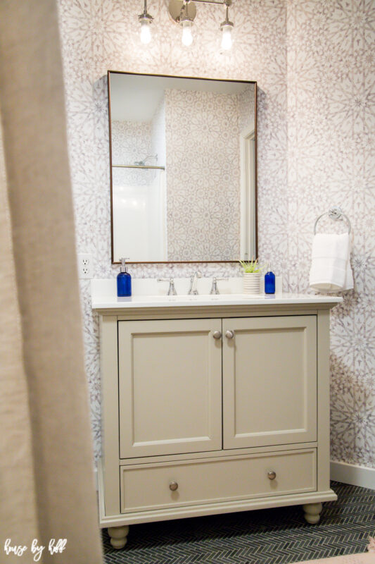Bathroom Wallpaper, Greige Vanity, Rectangle Mirror and Chrome Light Fixture