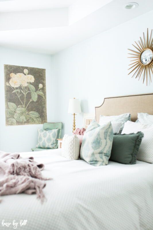 Master bedroom with large scale floral art on decorative paper from Walmart