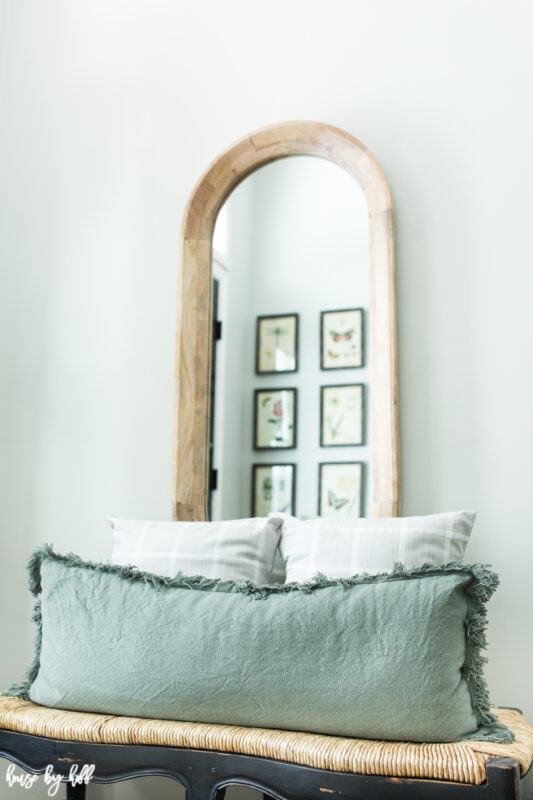 Oval Wood Mirror with Bench and Green Lumbar Pillow
