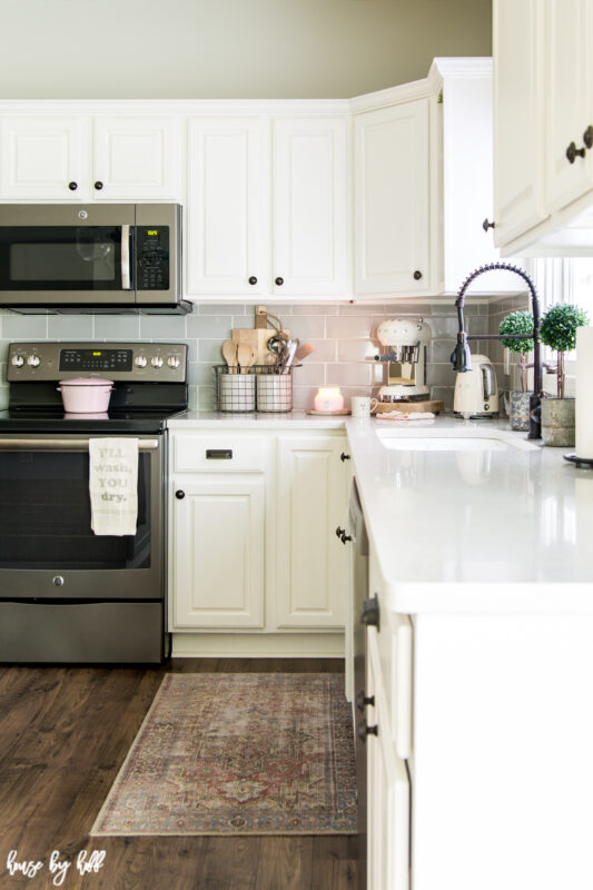 White Kitchen with Pops of Pink and Black Faucet