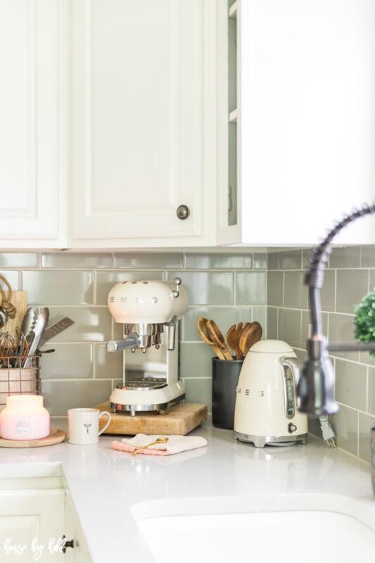 White Smeg Appliances in Gray and White Kitchen