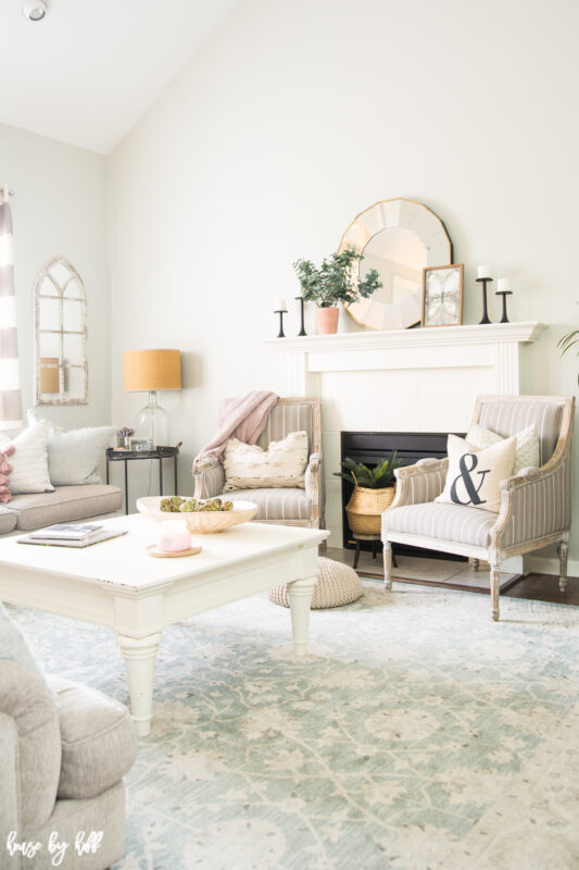 Bright Gray Living Room with Antique Blue Rug and White Furniture
