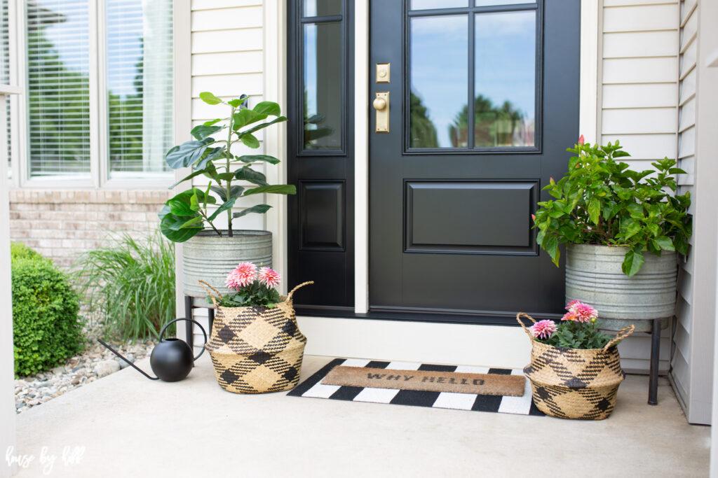 Black Front Door and Sidelight with Brass Doorknob