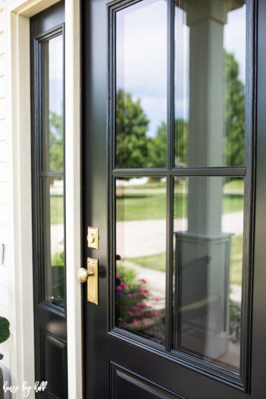 Black Four Pane Front Door with Brass Doorknob