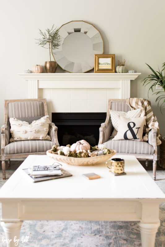 Neutral living room with fall decor and gold accents