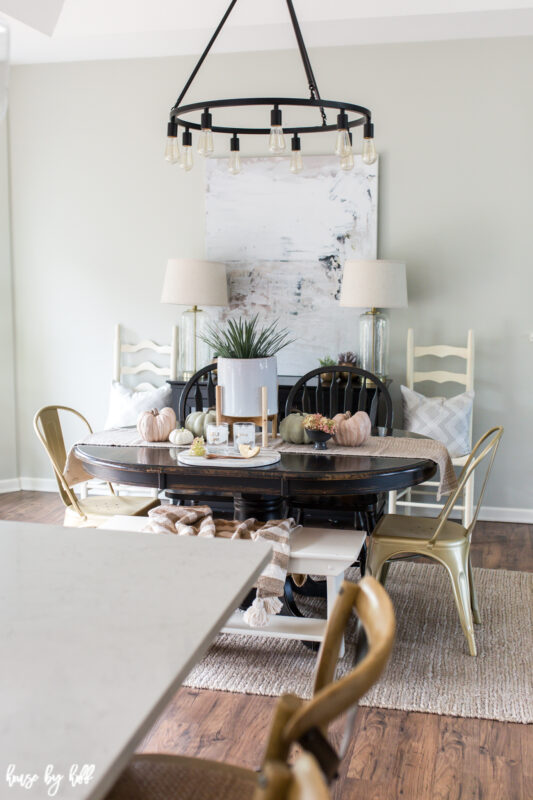 Dining room with modern art and neutral fall decor