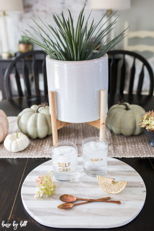 White footed planter on dining table