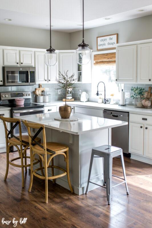 Kitchen with white quartz countertops and white cabinets