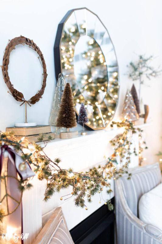 Elegant Holiday Living Room with Asymmetrical Mantel Garland