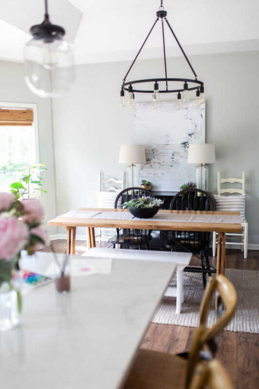 Dining area with black industrial light fixture and modern farmhouse table