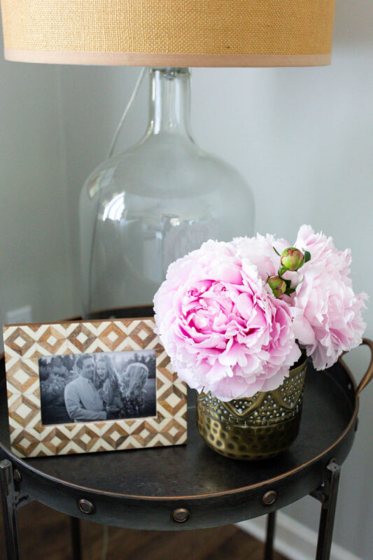 Pretty side table with peonies and frame