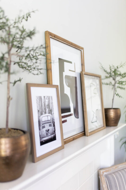 Mantel with black and white artwork