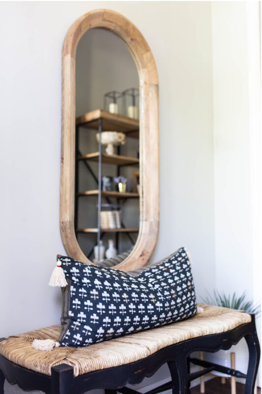 Small foyer with wood mirror and bench